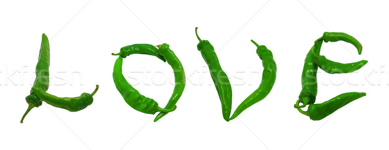 Love text composed of green peppers Stock photo © BSANI