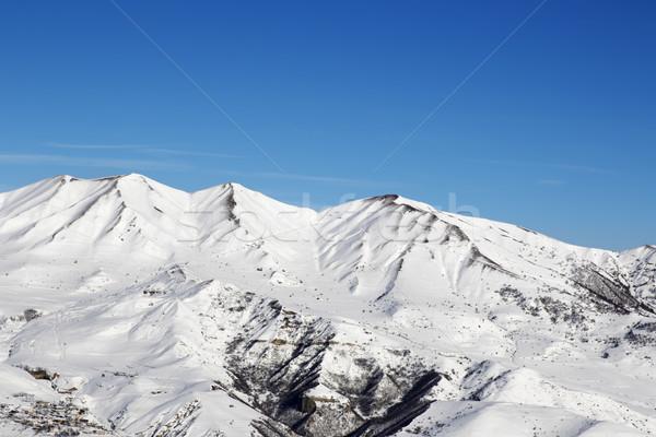 Snowy winter mountains at nice sun day Stock photo © BSANI