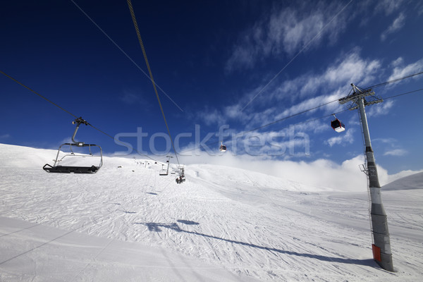 Gondola and chair lift at nice sunny day Stock photo © BSANI