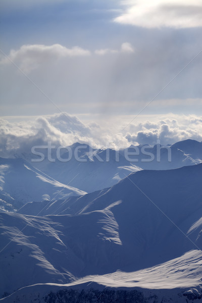 Winter mountains in evening haze Stock photo © BSANI