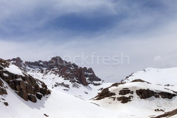 Snow mountains in fog Stock photo © BSANI