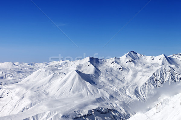 Snow mountains and blue clear sky Stock photo © BSANI