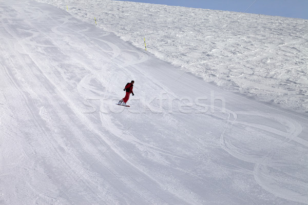 Ski slope and snowboarder at cold day Stock photo © BSANI