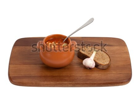 Borsch with bread and garlic on wooden kitchen board Stock photo © BSANI