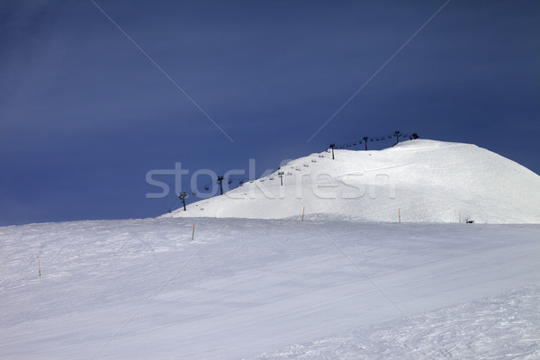 Ski slope and ropeway against blue sky Stock photo © BSANI
