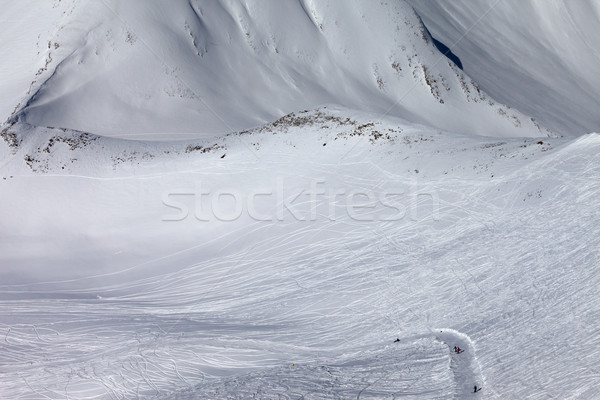 Stock photo: Snowboarders and skiers on slope and off-piste slope with trace