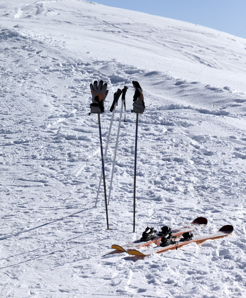 Skiing equipment on ski slope at sunny day Stock photo © BSANI
