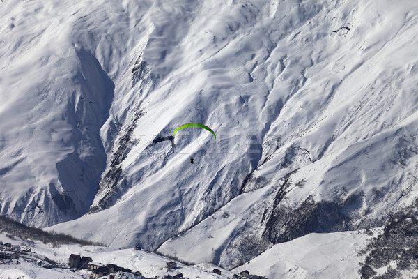 Speed flying in snow mountains in sunny nice day Stock photo © BSANI