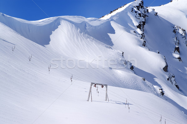 Old surface lift and mountains with snow cornice Stock photo © BSANI