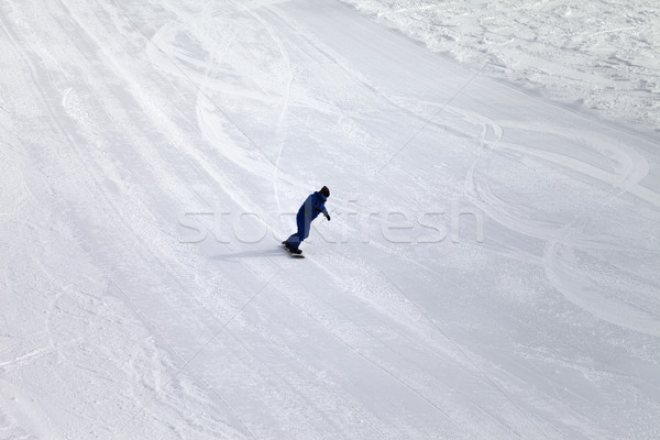 Ski slope and snowboarder at sun day Stock photo © BSANI