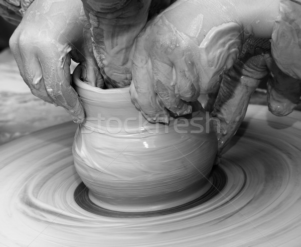 Beginner and teacher in process of making clay bowl on pottery w Stock photo © BSANI