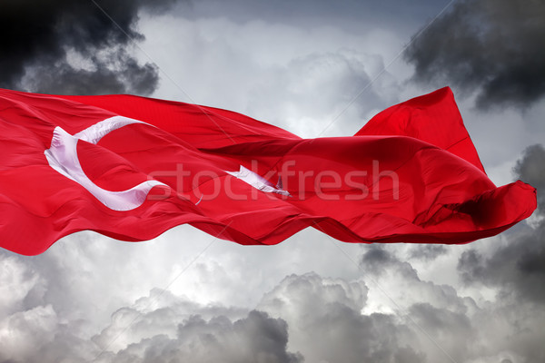 Waving flag of Turkey against storm clouds Stock photo © BSANI