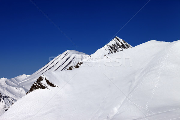 Off-piste slope with traces of skis in nice day Stock photo © BSANI