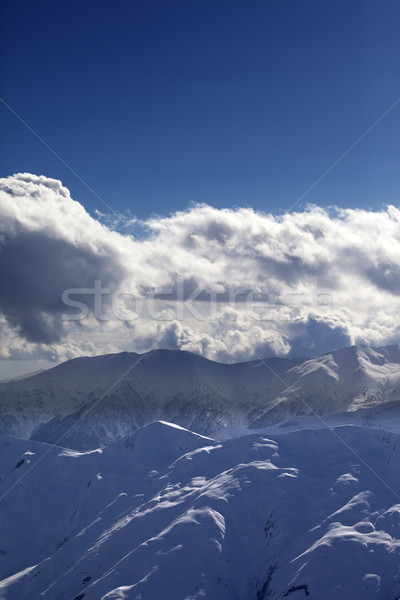 Evening mountains and sunlight clouds Stock photo © BSANI
