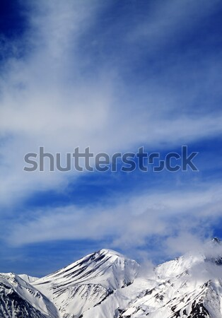 Winter snowy mountains and sky with clouds at nice day Stock photo © BSANI