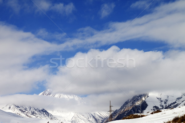 Ski slope and blue sky with clouds Stock photo © BSANI