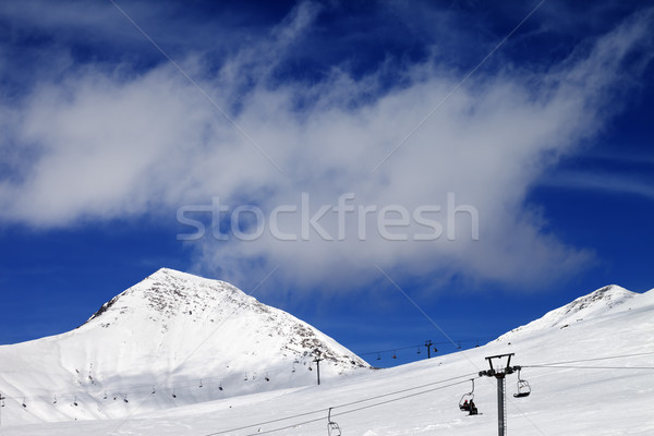 Chair-lift and ski slope at sun day Stock photo © BSANI