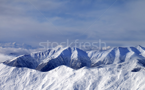 Winter mountains in clouds at windy day Stock photo © BSANI