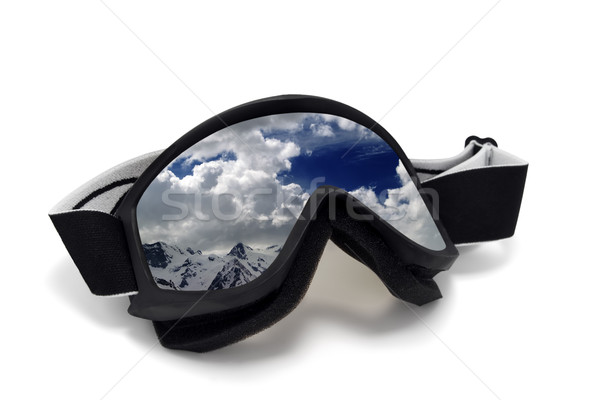 Ski goggles with reflection of cloudy mountains Stock photo © BSANI
