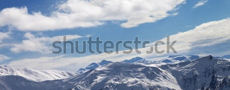 Panoramic view on sunlight snowy mountains Stock photo © BSANI
