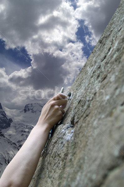 Climber's hand with quick-draws Stock photo © BSANI