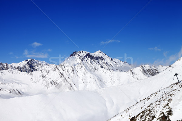 Off-piste slope and snowy mounts against blue sky Stock photo © BSANI