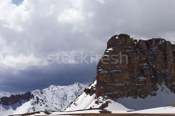 Snowy rocks and cloudy sky Stock photo © BSANI