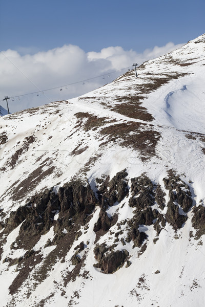 Off-piste slope with stones and chair-lift in little snow year Stock photo © BSANI
