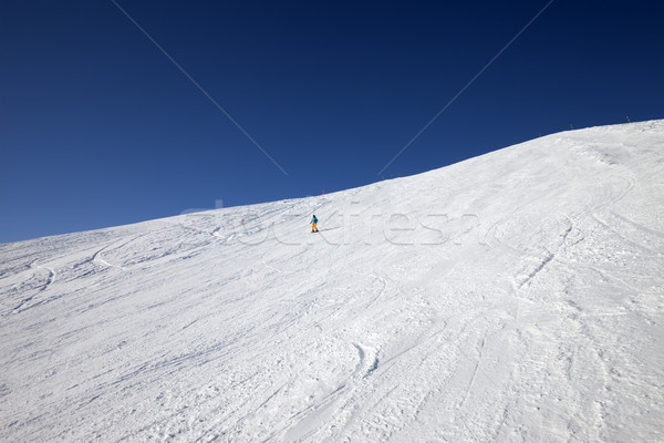 Skier on slope in sun day Stock photo © BSANI