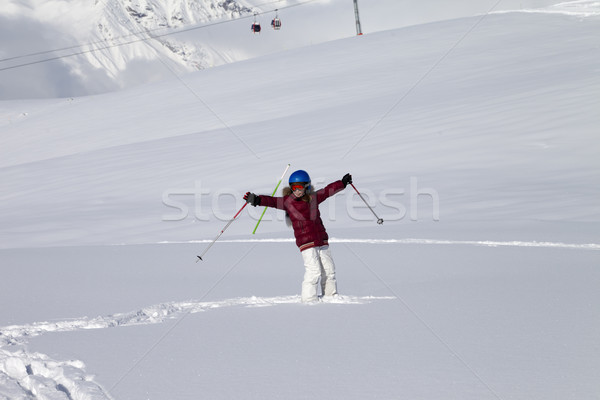 Happy girl on off-piste slope with new fallen snow at nice sun d Stock photo © BSANI