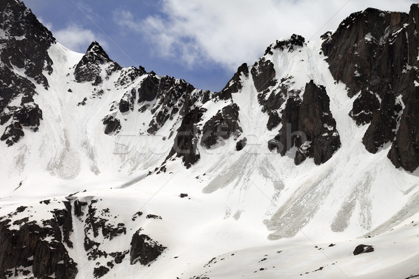 Snow rocks with traces from avalanche in sun spring day Stock photo © BSANI