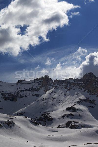 Snow mountains and blue sky with clouds Stock photo © BSANI
