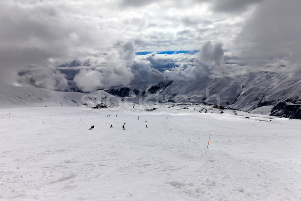 Stock photo: Skiers on ski slope before storm
