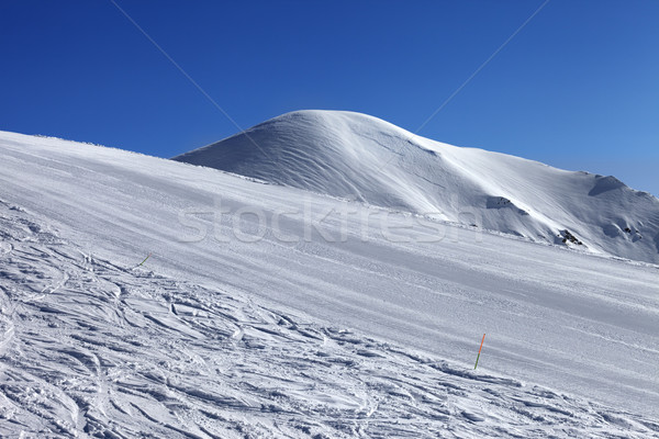 Ski slope and blue cloudless sky in nice winter day Stock photo © BSANI