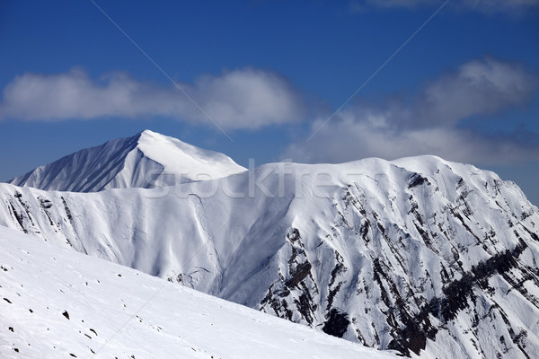 Off-piste slope with stones and mountains with trace of avalanch Stock photo © BSANI