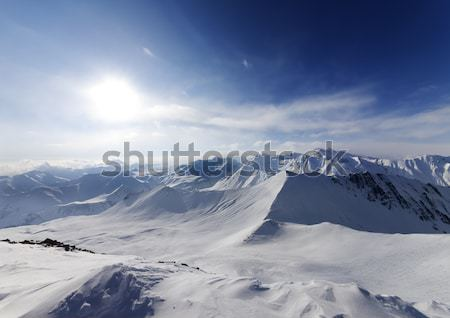 Snowy mountains and off-piste slope at nice day Stock photo © BSANI