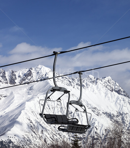 Chair lift in snowy mountains at nice sun day Stock photo © BSANI