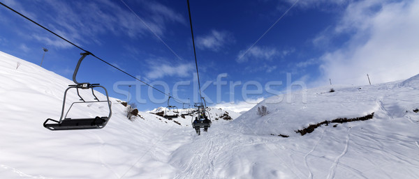 Panoramic view on chair-lift at ski resort at sun winter day Stock photo © BSANI