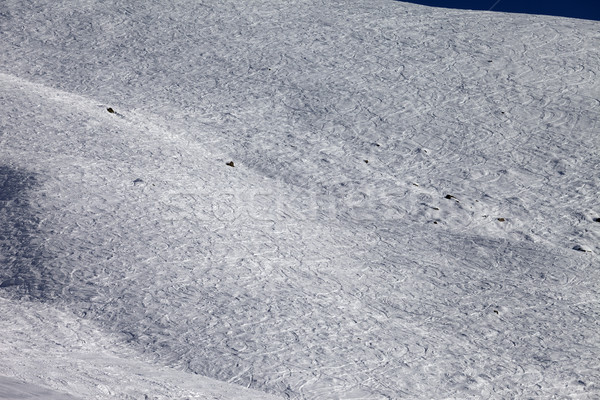 Traces of skis and snowboards on off-piste slope at sun day Stock photo © BSANI