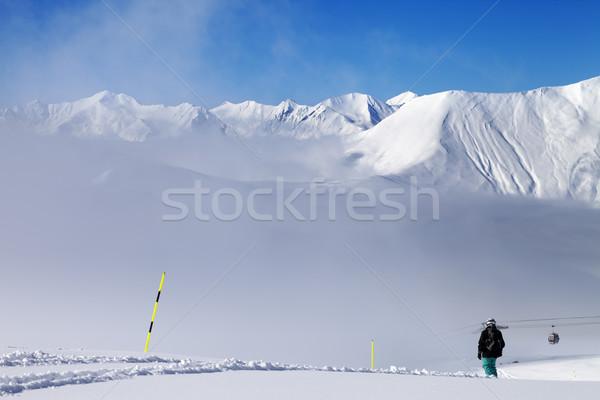 Snowboarder montagna nebbia caucaso Georgia Foto d'archivio © BSANI