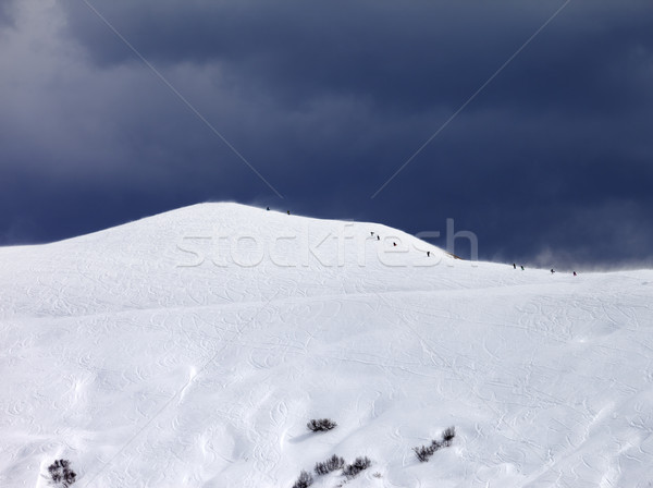 Off-piste slope and storm gray sky in bad weather day Stock photo © BSANI