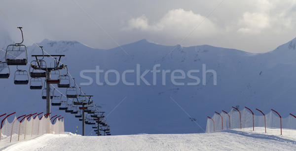 Panoramic view on snow skiing piste and ropeway Stock photo © BSANI