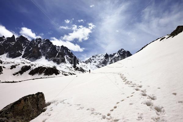 Snow mountain in sun spring day Stock photo © BSANI