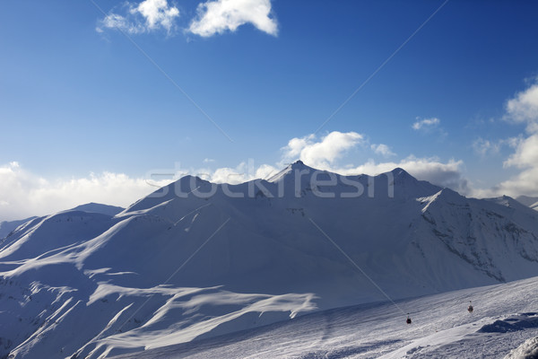 View on ski slope and beautiful mountains in evening Stock photo © BSANI