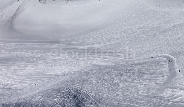 Skiers and snowboarders on off-piste slope in sun day Stock photo © BSANI
