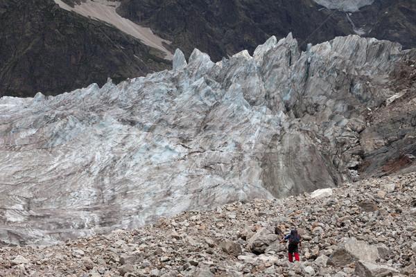 Hiker on glacier moraine Stock photo © BSANI