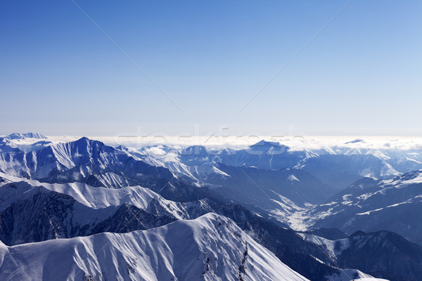 View from off-piste slope on snowy rocks in haze Stock photo © BSANI