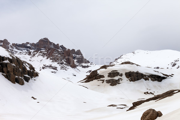 Snow mountains at cloudy day Stock photo © BSANI