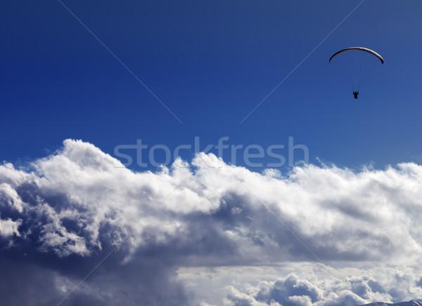 Sziluett kék napos égbolt Kaukázus hegyek Stock fotó © BSANI