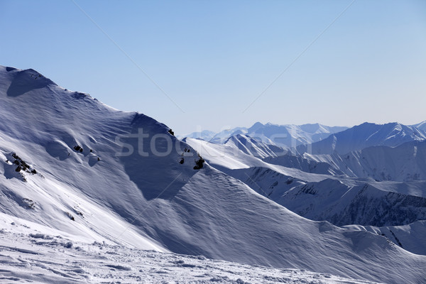 Off-piste slope and snowy mountains in morning Stock photo © BSANI